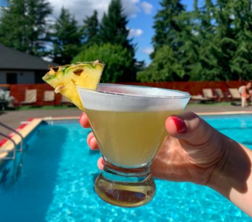 margarita pool poolside pineapple garnish sunny day